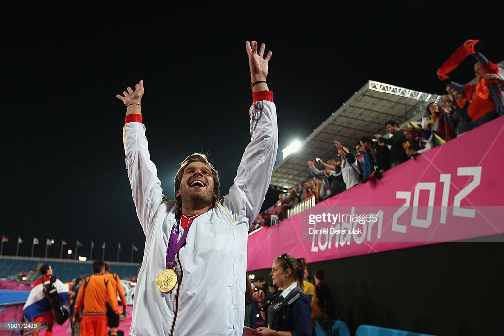 <a gi-track='captionPersonalityLinkClicked' href=/galleries/search?phrase=Moritz+Fuerste&family=editorial&specificpeople=657212 ng-click='$event.stopPropagation()'>Moritz Fuerste</a> of Germany celebrates with his gold medal after the Men's Hockey gold medal match against Netherlands on Day 15 of the London 2012 Olympic Games at Hockey Centre on August 11, 2012 in London, England.