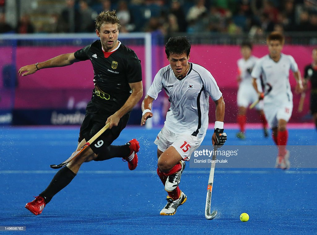 <a gi-track='captionPersonalityLinkClicked' href=/galleries/search?phrase=Moritz+Fuerste&family=editorial&specificpeople=657212 ng-click='$event.stopPropagation()'>Moritz Fuerste</a> of Germany challenges Jong Bok Cha of South Korea for the ball during the Men's preliminary Hockey match between South Korea and Germany on Day 5 of the London 2012 Olympic Games at Riverbank Arena on August 1, 2012 in London, England.