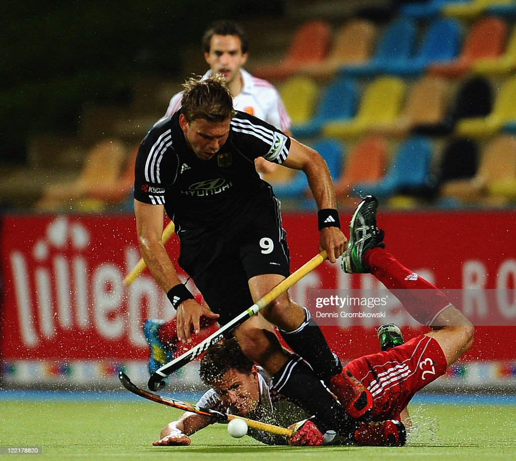 Moritz Fuerste (up) of Germany is challenged by Iain Mackay (below) of England during the Men's Eurohockey 2011 semi final match between Germany and England at Warsteiner HockeyPark on August 26, 2011 in Moenchengladbach, Germany.