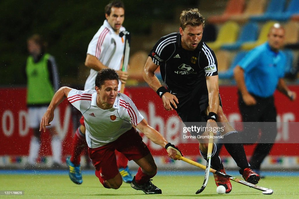 Moritz Fuerste (R) of Germany is challenged by Iain Mackay (L) of England during the Men's Eurohockey 2011 semi final match between Germany and England at Warsteiner HockeyPark on August 26, 2011 in Moenchengladbach, Germany.