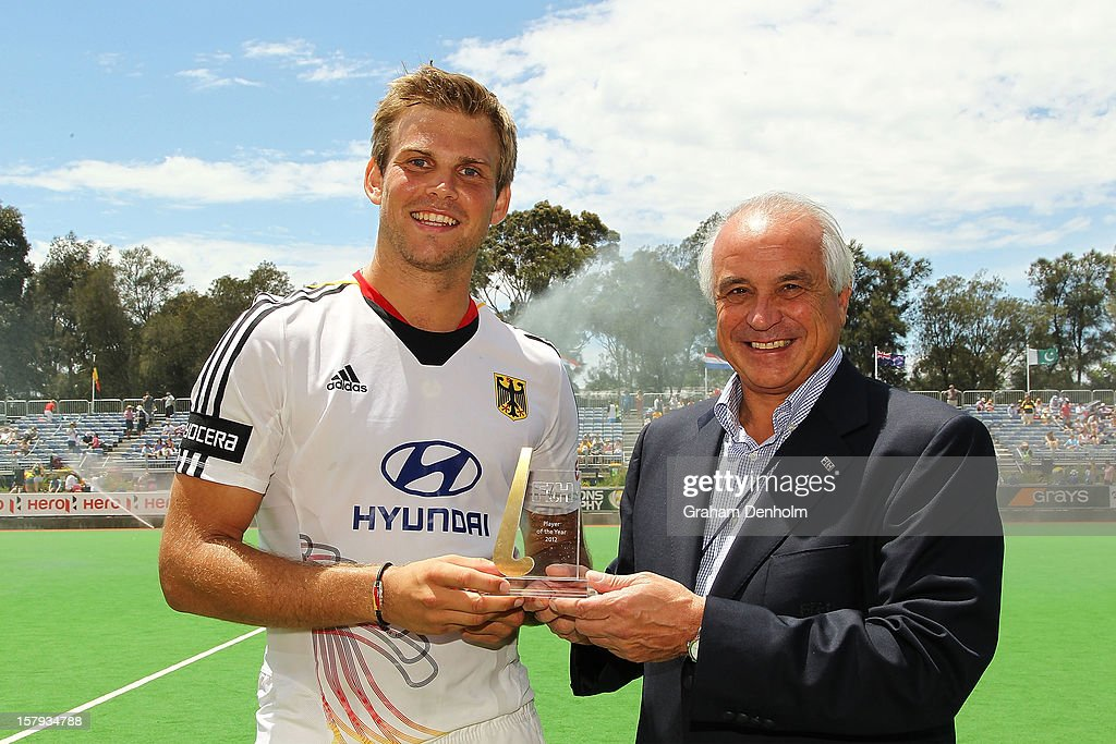 <a gi-track='captionPersonalityLinkClicked' href=/galleries/search?phrase=Moritz+Fuerste&family=editorial&specificpeople=657212 ng-click='$event.stopPropagation()'>Moritz Fuerste</a> of Germany (L) is presented with the FIH 2012 Player of the Year Award by FIH President Leandro Negre during day five of the 2012 Champions Trophy at the State Netball and Hockey Centre on December 8, 2012 in Melbourne, Australia.