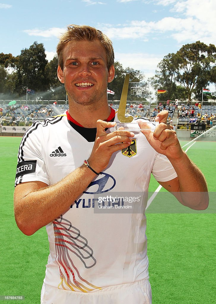 Moritz Fuerste of Germany poses with the FIH 2012 Player of the Year Award after being presented with the award during day five of the 2012 Champions Trophy at the State Netball and Hockey Centre on December 8, 2012 in Melbourne, Australia.