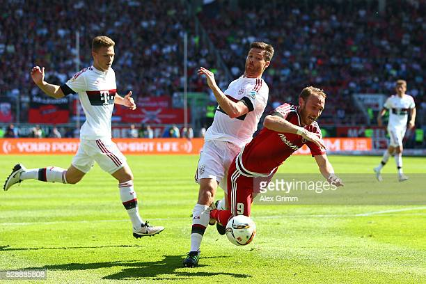 Moritz Hartmann of FC Ingolstadt is fouled by Xabi Alonso of Bayern Muenchen resulting in a penalty during the Bundesliga match between FC Ingolstadt...