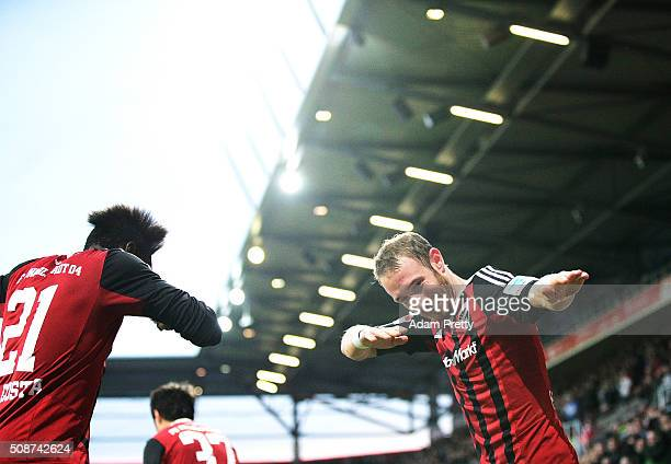 Moritz Hartmann of Ingolstadt 04 celebrates scoring a penalty goal during the Bundesliga match between FC Ingolstadt and FC Augsburg at Audi...