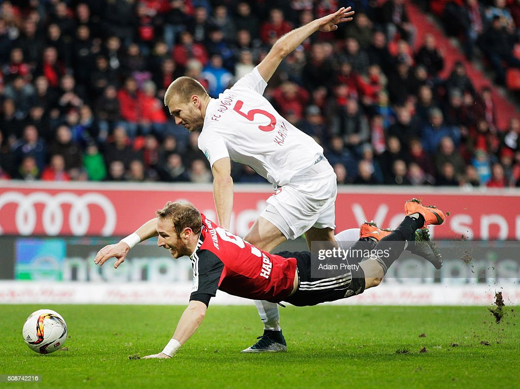 Moritz Hartmann of Ingolstadt 04 is challenged by Ragnar Klavan of Augsburgl during the Bundesliga match between FC Ingolstadt and FC Augsburg at Audi Sportpark on February 6, 2016 in Ingolstadt, Germany.