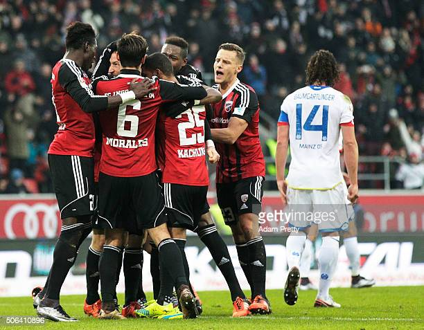 Moritz Hartmann of Ingolstadt 04 is congratulated after scoring a penalty goal during the Bundesliga match between FC Ingolstadt and FSV Mainz at...