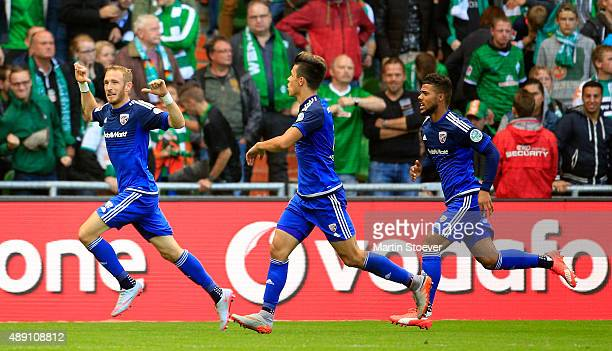 Moritz Hartmann of Ingolstadt celebrates his goal during the Bundesliga match between Werder Bremen and FC Ingolstadt at Weserstadion on September 19...