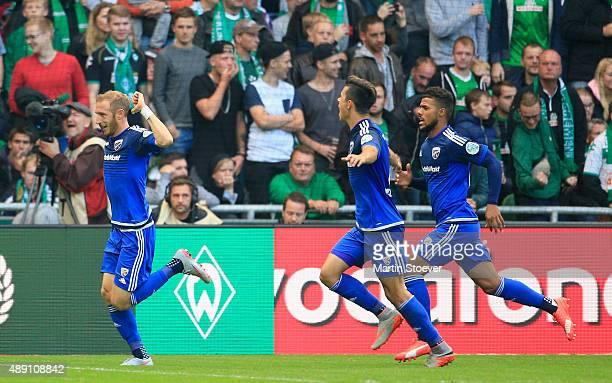 Moritz Hartmann of Ingolstadt celebrates his goal during the Bundesliga match between Werder Bremen and FC Ingolstadt at Weserstadion on September 19...