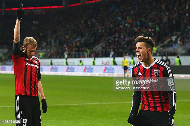 Moritz Hartmann of Ingolstadt celebrates scoring the second team goal with his team mate Alfredo Morales during the Bundesliga match between FC...