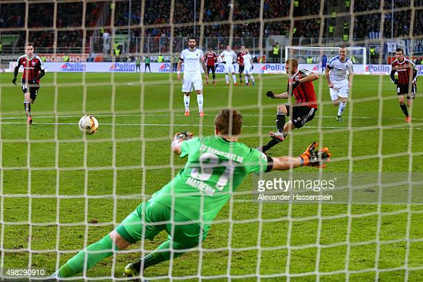 Moritz Hartmann of Ingolstadt scores the second team goal with a penalty against Christian Mathenia keeper of Darmstadt during the Bundesliga match...