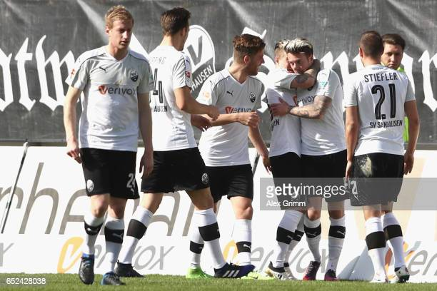 Moritz Kuhn of Sandhausen celebrates scoring teh opening goal with his team mates during the Second Bundesliga match between SV Sandhausen and SpVgg...