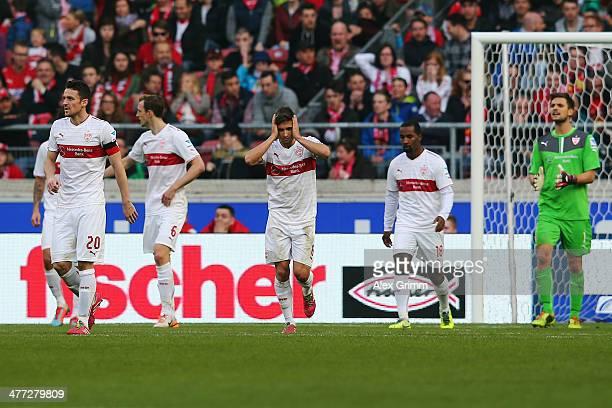 Moritz Leitner and team mates of Stuttgart react after Emin Bicakcic of Braunschweig scored his team's second goal during the Bundesliga match...