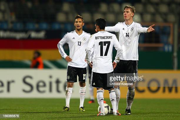 Moritz Leitner Leonardo Bittencourt and Sebastian Polter of Germany look dejected after the 11 draw of the U21 International Friendly match between...