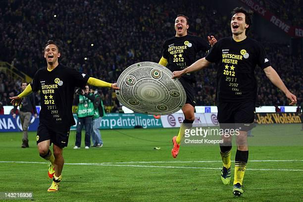 Moritz Leitner Mario Goetze and Mats Hummels of Dortmund celebrate winning the German Championships after winning 20 the 1 Bundesliga match between...