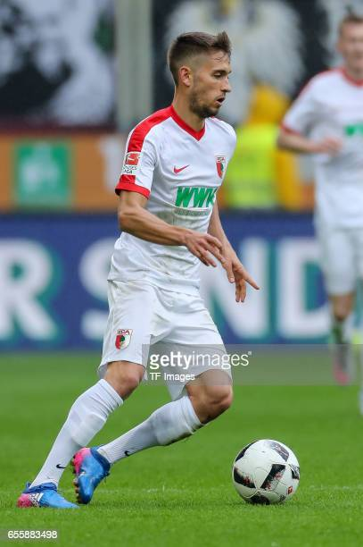 Moritz Leitner of Augsburg controls the ball during the Bundesliga match between FC Augsburg and SC Freiburg at WWK Arena on March 18 2017 in...