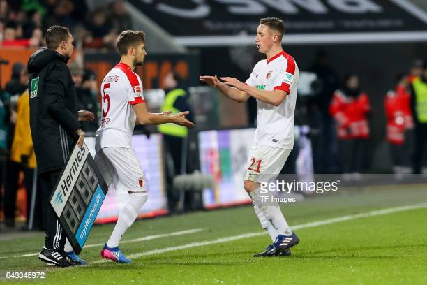 Moritz Leitner of Augsburg shakes hands with Dominik Kohr of Augsburg during the Bundesliga match between FC Augsburg and Bayer 04 Leverkusen at WWK...