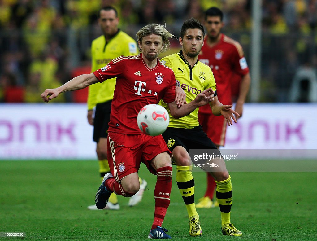 Moritz Leitner (R) of Dortmund challenges Anatoliy Tymoshchuk of Muenchen during the Bundesliga match between Borussia Dortmund and FC Bayern Muenchen at Signal Iduna Park on May 4, 2013 in Dortmund, Germany.