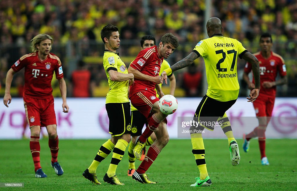 Moritz Leitner (2nd L) of Dortmund challenges Thomas Mueller of Muenchen during the Bundesliga match between Borussia Dortmund and FC Bayern Muenchen at Signal Iduna Park on May 4, 2013 in Dortmund, Germany.