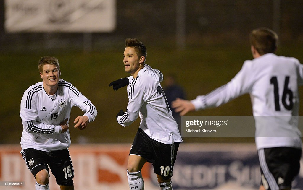 Moritz Leitner (C) of Germany celebrates his goal with team-mates Johannes Wurtz (L) and Markus Mendler during the international friendly match between U20 Switzerland and U20 Germany at Eps Stadium on March 26, 2013 in Baden, Switzerland