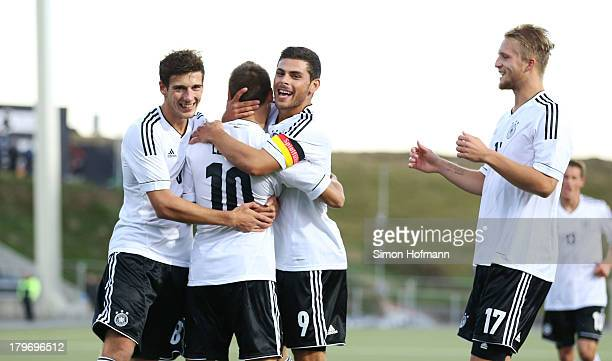 Moritz Leitner of Germany celebrates his team's first goal with teammates Kevin Volland and Leon Goretzka during the UEFA Under21 Euro 2015 Qualifier...