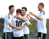 Moritz Leitner of Germany celebrates his team's first goal with teammates Leon Goretzka Kevin Volland and Philipp Hofmann during the UEFA Under21...