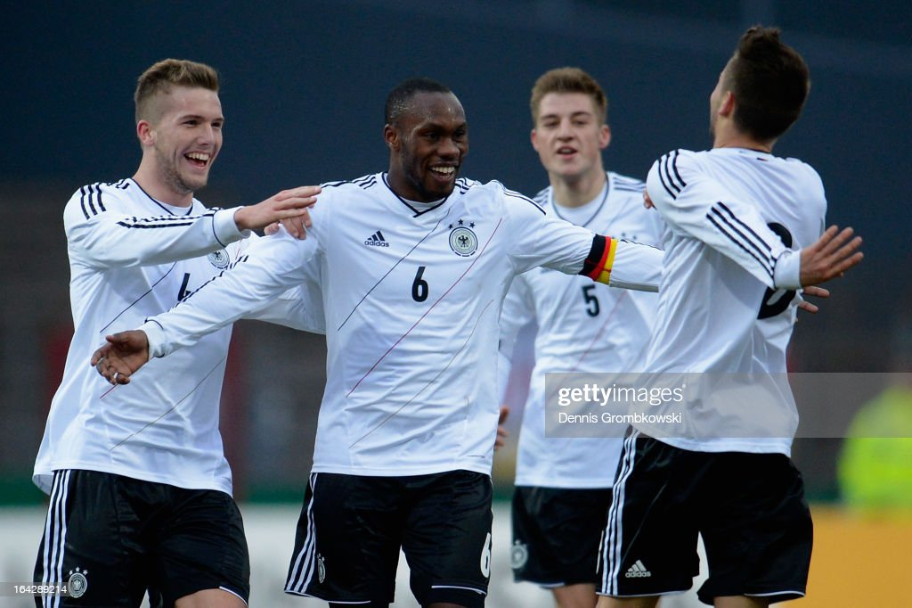 Moritz Leitner of Germany celebrates with teammates Reinhold Yabo and Andre Hoffmann after scoring his team's second goal during the International Friendly match between U20 Germany and U20 Switzerland on March 22, 2013 in Cologne, Germany.