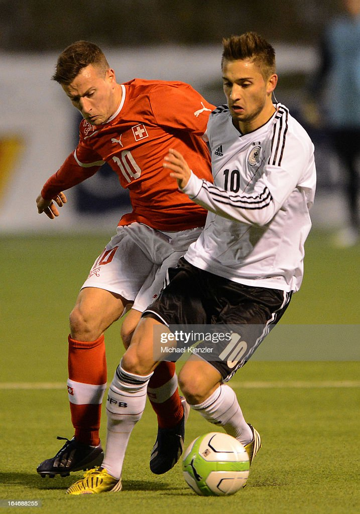 Moritz Leitner of Germany (r) challenges Mergim Brahimi during the international friendly match between U20 Switzerland and U20 Germany at Eps Stadium on March 26, 2013 in Baden, Switzerland