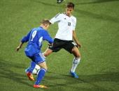 Moritz Leitner of Germany is challenged by Ari Ellingsgaard of Faroe Islands during the UEFA Under21 Euro 2015 Qualifier match between Faroe Islands...
