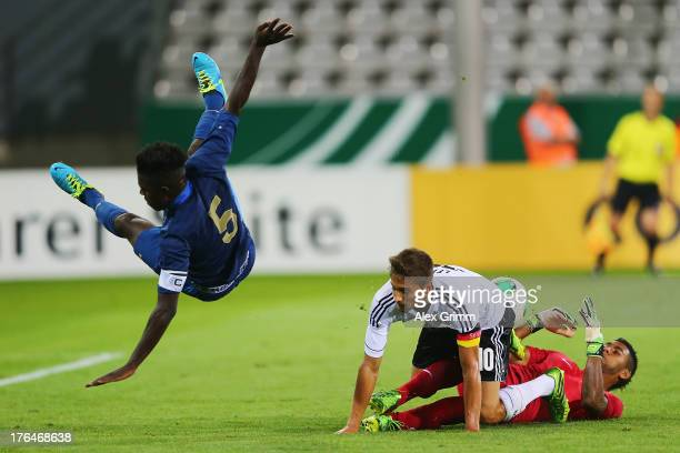 Moritz Leitner of Germany is challenged by goalkeeper Zacharie Boucher and Samuel Umtiti of France during the U21 match between Germany and France on...