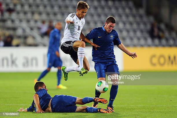 Moritz Leitner of Germany is challenged by Jordan Veretout and Alexandre Coeff of France during the U21 match between Germany and France on August 13...