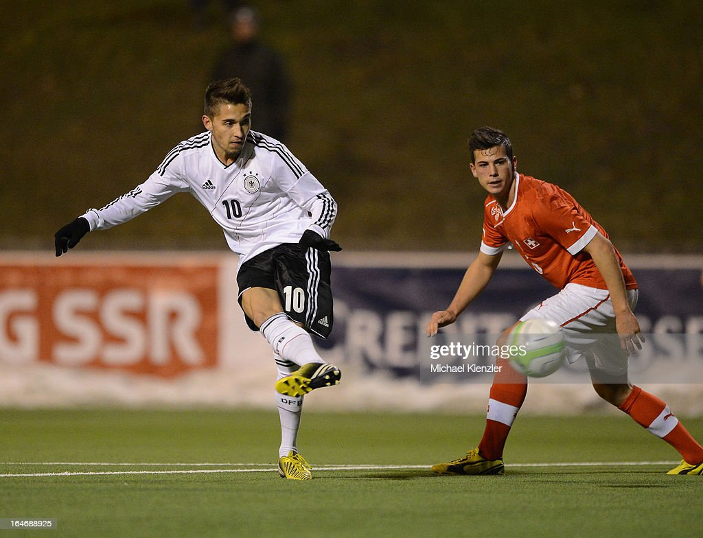 Moritz Leitner (L) of Germany scores the third goal against past Remo Freuler of Switzerland during the international friendly match between U20 Switzerland and U20 Germany at Eps Stadium on March 26, 2013 in Baden, Switzerland