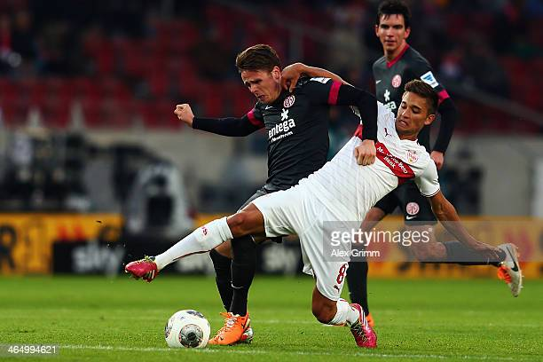 Moritz Leitner of Stuttgart is challenged by Nicolai Mueller of Mainz during the Bundesliga match between VfB Stuttgart and 1 FSV Mainz 05 at...