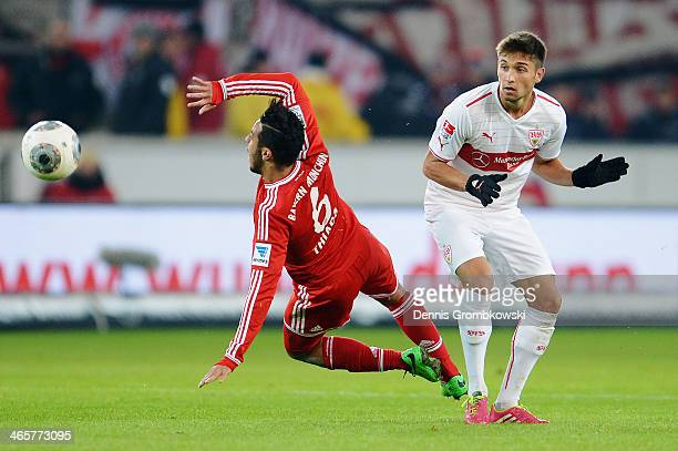 Moritz Leitner of VfB Stuttgart challenges Thiago of FC Bayern Muenchen during the Bundesliga match between VfB Stuttgart and FC Bayern Muenchen at...
