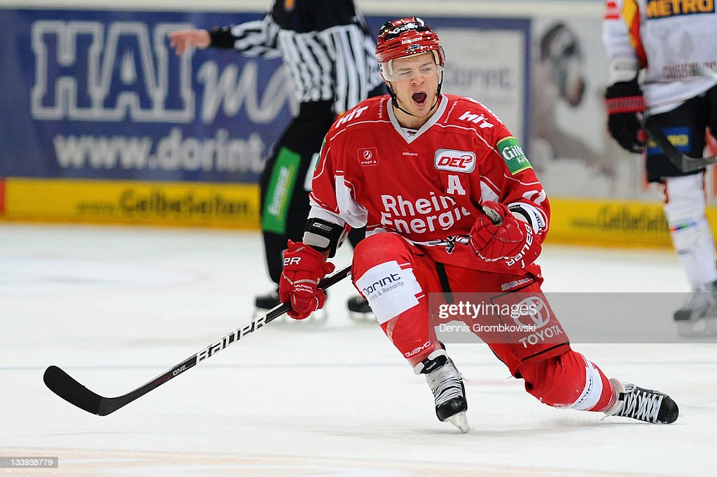 <a gi-track='captionPersonalityLinkClicked' href=/galleries/search?phrase=Moritz+Mueller&family=editorial&specificpeople=853045 ng-click='$event.stopPropagation()'>Moritz Mueller</a> of Cologne celebrates after scoring his team's second goal during the DEL match between Koelner Haie and DEG Metro Stars at Lanxess Arena on November 22, 2011 in Cologne, Germany.