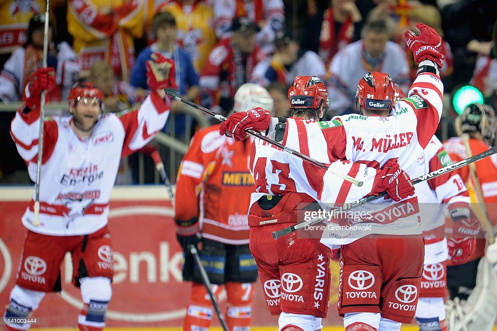 <a gi-track='captionPersonalityLinkClicked' href=/galleries/search?phrase=Moritz+Mueller&family=editorial&specificpeople=853045 ng-click='$event.stopPropagation()'>Moritz Mueller</a> of Cologne celebrates with teammate <a gi-track='captionPersonalityLinkClicked' href=/galleries/search?phrase=Alexander+Weiss&family=editorial&specificpeople=2279179 ng-click='$event.stopPropagation()'>Alexander Weiss</a> after scoring his team's second goal during the DEL match between DEG Metro Stars and Koelner Haie at ISS Dome on March 9, 2012 in Duesseldorf, Germany.