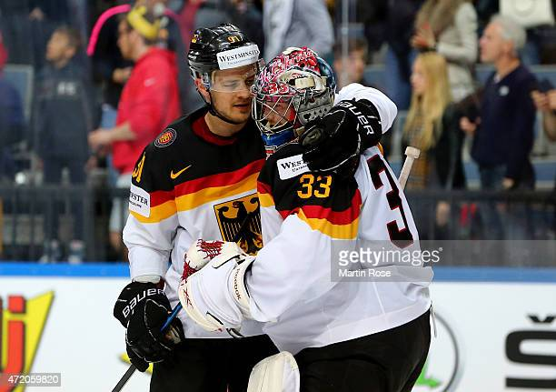 Moritz Mueller of Germany comforts team mate Danny aus den Birken after the IIHF World Championship group A match between Canada and Germany on May 3...