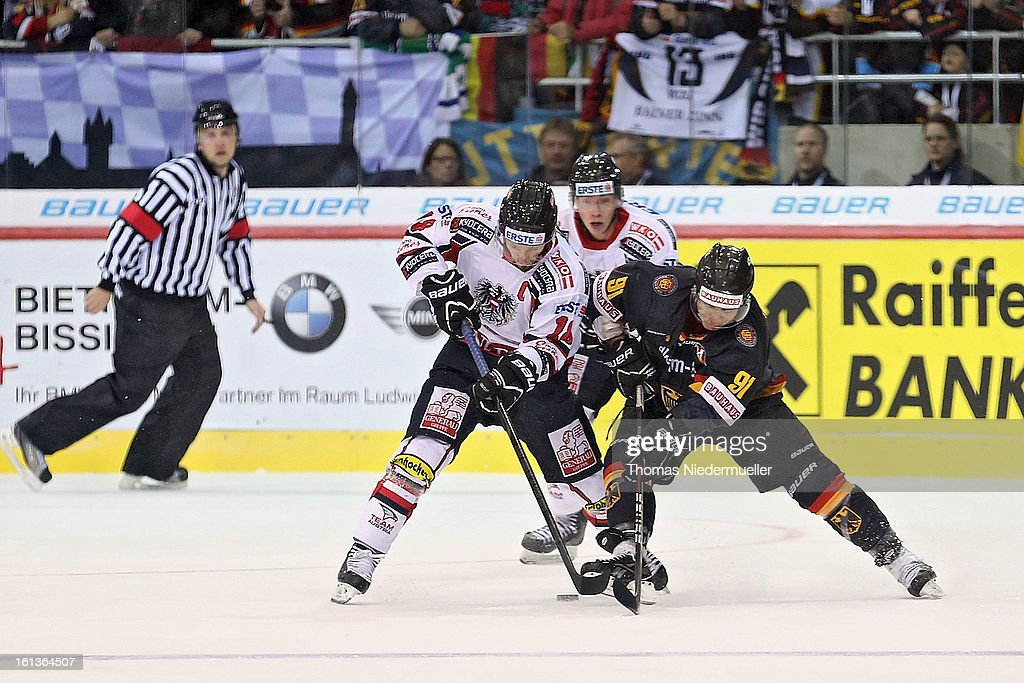 <a gi-track='captionPersonalityLinkClicked' href=/galleries/search?phrase=Moritz+Mueller&family=editorial&specificpeople=853045 ng-click='$event.stopPropagation()'>Moritz Mueller</a> (R) of Germany fights for the puck with Thomas Koch (L) of Austria during the Olympic Icehockey Qualifier match between Germany and Austria on February 10, 2013 in Bietigheim-Bissingen, Germany.