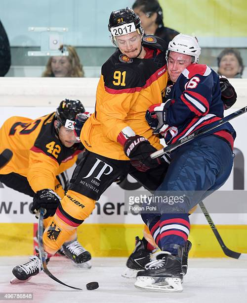 Moritz Mueller of Team Germany and Travis Turnbull of Team USA during the game between Germany against USA on november 8 2015 in Augsburg Germany