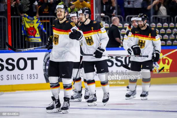 Moritz Muller and team members of Germany celebrate after penalty shot out after the 2017 IIHF Ice Hockey World Championship game between Germany and...