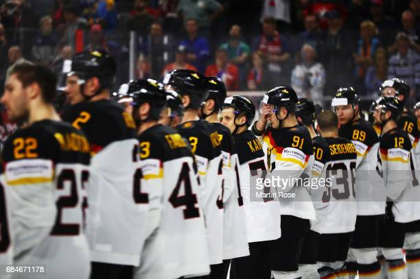 Moritz Muller of Germany and team mates are dejected after losing the 2017 IIHF Ice Hockey World Championship Quarter Final game between Canada and...