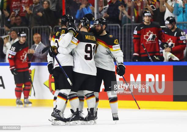 Moritz Muller of Germany and team mates celebrate during the 2017 IIHF Ice Hockey World Championship Quarter Final game between Canada and Germany at...