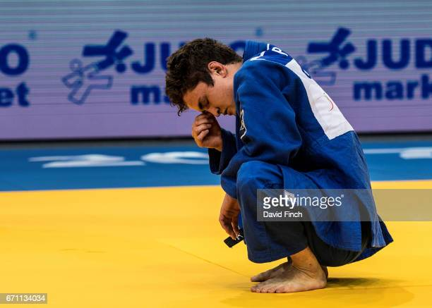 Moritz Plafky of Germany is distraught after losing his opening contest to an ippon throw by Matjaz Trbovc of Slovenia in extra time to lose the...