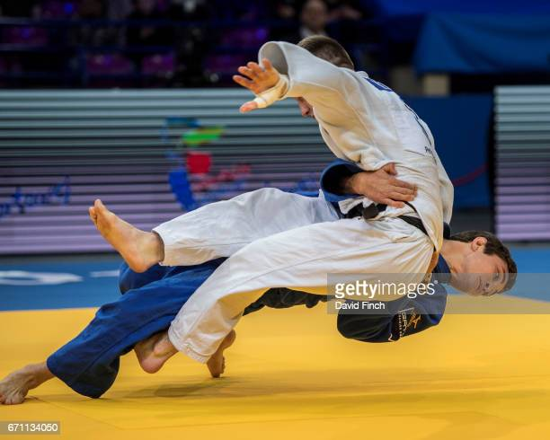 Moritz Plafky of Germany throws Matjaz Trbovc of Slovenia without a score eventually losing the u60kg contest to the Slovenian during the 2017 Warsaw...