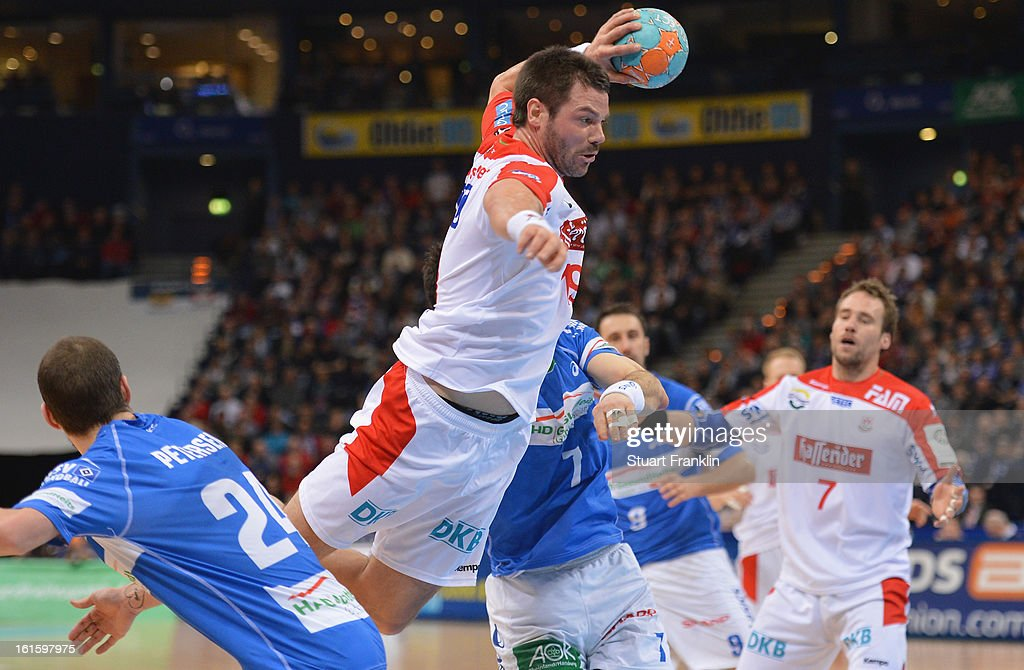 Moritz Schaepsmeier of Magdeburg is challenged during the Bundesliga match between Hamburger SV and SC Magdeburg at the O2 world on February 12, 2013 in Hamburg, Germany.