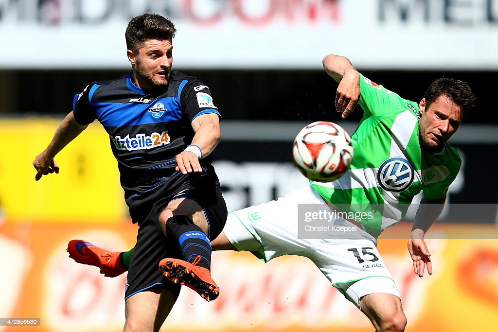 Moritz Stoppelkamp of Paderborn and Christian Traesch of Wolfsburg go up for a header during the Bundesliga match between SC Paderborn 07 and VfL...