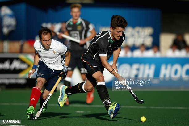 Moritz Trompertz of Germany attempts to get away from JeanLaurent Kieffer of France during the Quarter final match between Germany and France during...