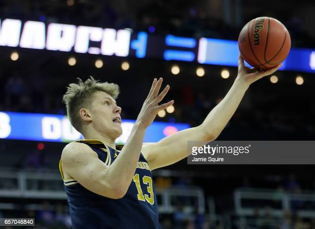 Moritz Wagner of the Michigan Wolverines attempts a shot against the Oregon Ducks during the 2017 NCAA Men's Basketball Tournament Midwest Regional...