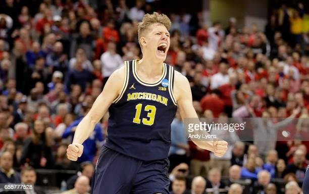 Moritz Wagner of the Michigan Wolverines celebrates against the Louisville Cardinals during the second round of the NCAA Basketball Tournament at...