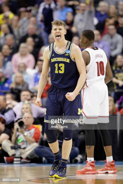 Moritz Wagner of the Michigan Wolverines celebrates in the second half against the Louisville Cardinals during the second round of the 2017 NCAA...