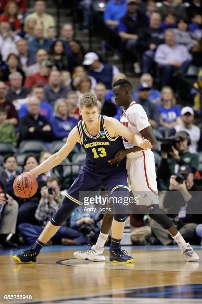 Moritz Wagner of the Michigan Wolverines drives against the Louisville Cardinals in the first half during the second round of the 2017 NCAA Men's...